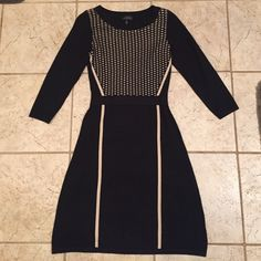 GORGEOUS knit Limited dress Fitted knit black dress that falls right below the knees w/ tan accents and flattering detail. I looooove this dress, only worn once for a wedding and in pristine condition. The Limited Dresses Midi