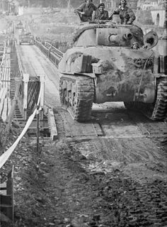 Sherman tanks crossing a Bailey bridge over the Seine at Vernon, 28 August 1944.