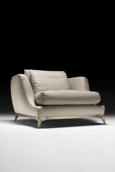 Upholstered to the highest standard in a high quality ivory Italian leather with piping detail, on an industrial style modern brushed bronzed metal base with defined striking structural detailing. The Large Leather Contemporary Designer Armchair is the epitome of comfort, enveloping you in luxury. To suit both a classic or contemporary interior, perfect in any setting. A statement of outstanding sophistication and elegance, a truly timeless piece. Indulge yourself!