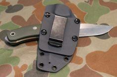 A custom Kydex knife sheath with spring clip on kydex plate by Custom Tactical Sheaths in Sydney