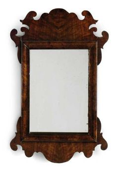 A SMALL GEORGE II WALNUT FRET-CARVED MIRROR  MID 18TH CENTURY  21¾ in. (55 cm.) high; 13½ in. (34 cm.) wide