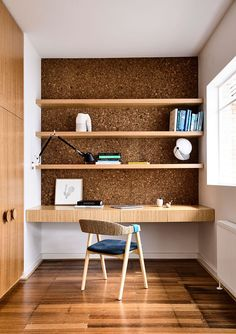 Space-savvy home workspace at the end of the hallway with floating shelves