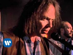 Neil Young - Harvest Moon. Harmonies and harmonica solo could work on flute. Play descending slide guitar minor arpeggio.