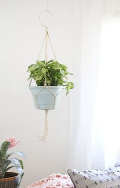 Learn how to make your own simple DIY Macrame Plant Hanger. This simple project is a fun way to add more greenery and life to your space.