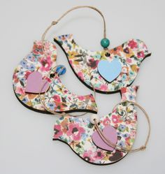 Our wooden bird shapes, covered with floral wrapping paper, painted hearts attached, and strung onto a piece of twine.