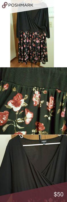 Torrid black and floral wrap dress Torrid size 3 or 22-24, black and floral wrap dress.  3/4 sleeves. only worn once torrid Dresses Midi