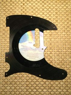 A personal favorite from my Etsy shop https://www.etsy.com/listing/457712650/telecaster-pickguard-made-from-record