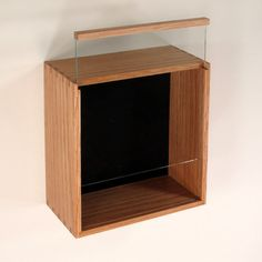 Simple Glass Display Case Shadow Box Design With Slide Up Model For The Picture Frame Door And using Smoothed Maple Wood For The Material Of This Simple Frame