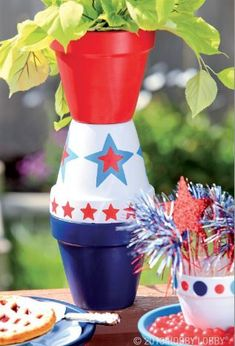 Can't get enough red, white and blue?  Make a patriotic plant stand! Apply acrylic  paint—make stars with stencils and make dots with a circular foam brush. Then, stack as shown and secure with all-purpose craft glue.