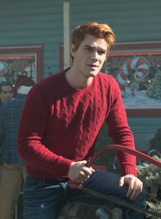 Riverdale: The campy, questionably glorious show where anything can happen. Like Archie kissing Joaquin in juvenile detention? Archie Andrews Riverdale, Riverdale Archie, Polo Cardigan, Sweater, Riverdale Season 1, Kj Apa Riverdale, Archie And Betty, Riverdale Fashion, Cole M Sprouse