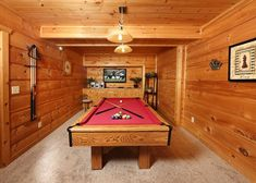 You will find a pool table, an arcade machine and a foosball table in the game room of A Wonderful Way cabin
