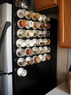 Spice storage genius...  Fridge, back splash, even right on your stove... so many magnetic options.