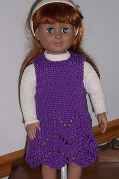 """This sweet little dress for the American Girl doll knits up quickly. The simple lace pattern is knitted on size 9, 8, and 7 needles starting at the bottom so that the skirt has a little extra """"swing"""". The crochet hook is only used to slip stitch or single crochet along the neck and arm edges. (That can be omitted if you don't crochet.)"""