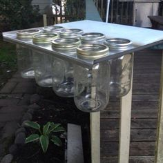 Hubby made this Mason Jar Herb Garden box out of stainless, with a cutting board & attached it to my deck railing! Mason Jar Herbs, Mason Jar Herb Garden, Herb Garden Pallet, Diy Herb Garden, Garden Plants, Mason Jars, Garden Ideas, Deck Railings, Potting Soil