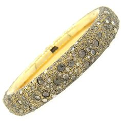 Pomellato Tango Gold Diamond Bangle Bracelet | From a unique collection of vintage bangles at https://www.1stdibs.com/jewelry/bracelets/bangles/