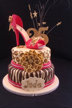 Birthday Cake Photos - Sugar shoe on top of  animal print cake.
