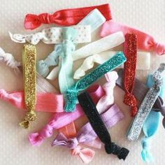 20 handmade hair ties for $9.99. Love the glittery gold and polka dot gold ones!