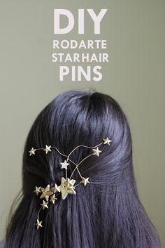 use barrette, wire, large star buttons, star rhinestones, E-6000 glue and gold spray paint to create star hair pins