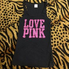 black tank top with pink glitter Victoria's Secret black tank top with pink glitter font. All glitter in tack. I only sleep in pink. Good condition! PINK Victoria's Secret Tops Tank Tops