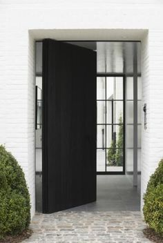Black pivot door entry