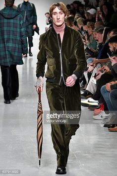 News Photo : A model walks the runway at the Oliver Spencer...