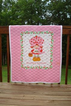 Vintage Strawberry Shortcake Quilt/Wall Hanging by michellesigmon, $50.00  *I totally had this Exact blanket but it had a pink ruffle around it!
