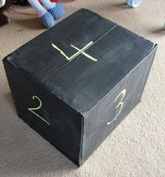 Box plus chalkboard paint create a quick set of dice and many other things too!