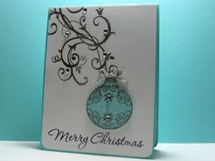 This elegant ornament takes center stage on this handmade Christmas card.  A silver-embossed flourish on the white card allows the teal ornament to shine.  Tie with silver ribbon and add some bling.