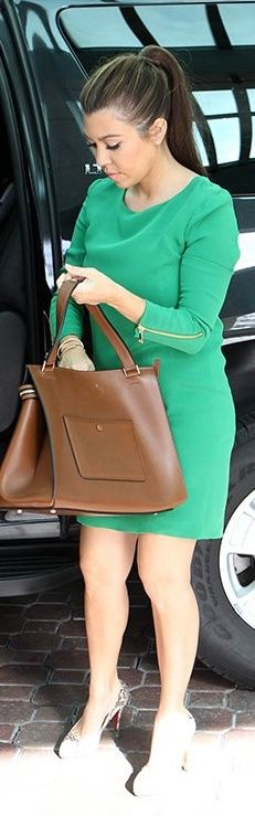 Who made Kourtney Kardashian's green dress, brown handbag, and snake pumps that she wore in Miami? Dress – Max Fowles  Purse – Celine  Shoes – Christian Louboutin