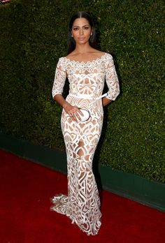 Brides.com: The 2014 Emmy Dresses Brides-to-Be Need to Check Out Matthew McConaughey's wife never shies away from showing off her curves and she did just that in a white off-the-shoulder Zuhair Murad gown with sultry cutout detailing and an edgy zigzag neckline. Her sleek hair, stud earrings, and flawless, yet minimal makeup let her dress play centerstage. P.S. hubby Matthew was wearing a prettysauve Dolce