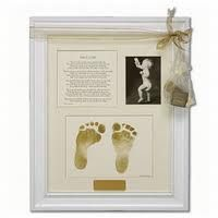 Feet prints, add baby pic and birth announcement.  Doing this for baby #3