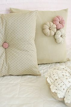Simple and easy to make cushions - love the handmade puffy flowers! :)