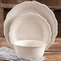 Just ordered 4 boxes of this for my new kitchen!! Can't wait!  The Pioneer Woman Cowgirl Lace 12-Piece Dinnerware Set - Walmart.com