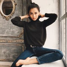 high-waisted jeans, tucked-in turtleneck sweater