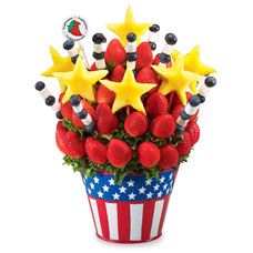 Would be a cute centerpiece and very expensive fruit bouquet but so cooL!