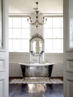 Vintage bathroom w/ a Venetian mirror.