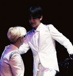 Suho enjoying as Baekhyun dances provacatively in front of him.