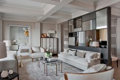 Jean Louis Deniot living room--neutral color palette, abstract mirror room divider, millwork