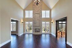 Light two story family room & stone fireplace