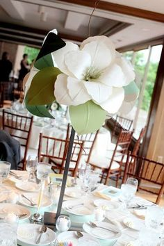 Consider Paper Source Magnolia paper flowers into reception centerpieces by arranging them in antique cut glass bowls and upside-down cake stands