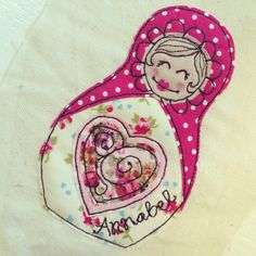 Russian doll picture using free motion embroidery