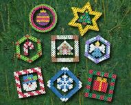 Christmas Ornaments Designed By The Perler Design Team Create eight colorful ornaments for your Christmas tree, wreath, or garland. The elements in the center are suspended with thread for a dimensional effect. These make a great family time activity!