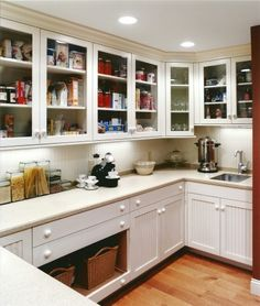 Pantry with Adjustable Shelves- In addition to a formal, traditional-style butler's pantry, this kitchen includes a more casual and contemporary walk-in pantry.