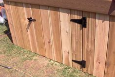 A gate installed in a deck skirt to allow for storage beneath the deck.