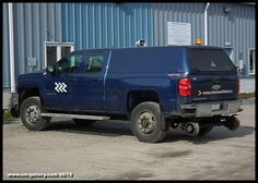 Captured at Cochrane's Yard Office June 6th is brand new hi-rail Chevy Silverado 2500 HD #867 ready for duty and complete with her new Corporate vehicle branding consisting of a lone white Chevron on the doors and website addy on the tailgate.