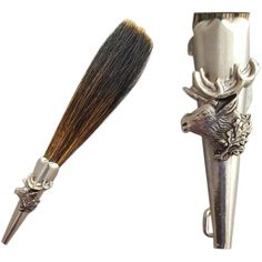 Vintage hunter's hat pin made with boar's hair / hackle, held in a silver tone metal tube, adorned with an elk head. Measures: 5 inches long. Strong