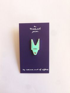 A ticket pin Enamel pin for all occasions. Comes on a small screen printed card. Great to wear to a party, while shopping, to a wedding or even