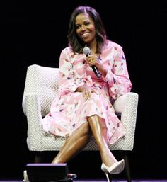Former #FirstLady #MichelleObama speaks, emphasizing that women must celebrate their strength, during a live conversation with The Women's Foundation of Colorado President and #CEO Lauren Y. Casteel at #PepsiCenter in #Denver #Colorado Tuesday night #June25th #2017 speaking to a crowd of some 8000 people