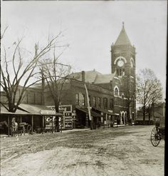 Marietta, ca. 1910. View of eastern side of square showing stores along it, looking southward toward courthouse.