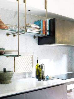 These light brass shelves are beautiful and not the least together with the marble.